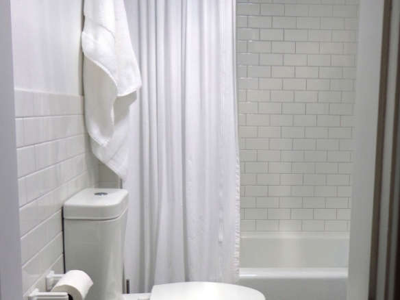 Steve Carbin Modern White Bath Remodelista Considered Design Awards Winner 584x438