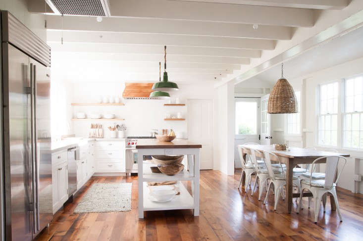 Above the airy kitchen features open shelving see rope pendant lights in a summer cottage to see how tracy sleuthed the green pendants