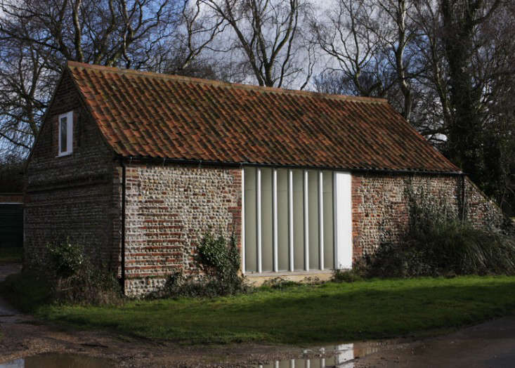 The Vertical Windows Integrate Well With Weathered Brick And Flint Existing Roof Had