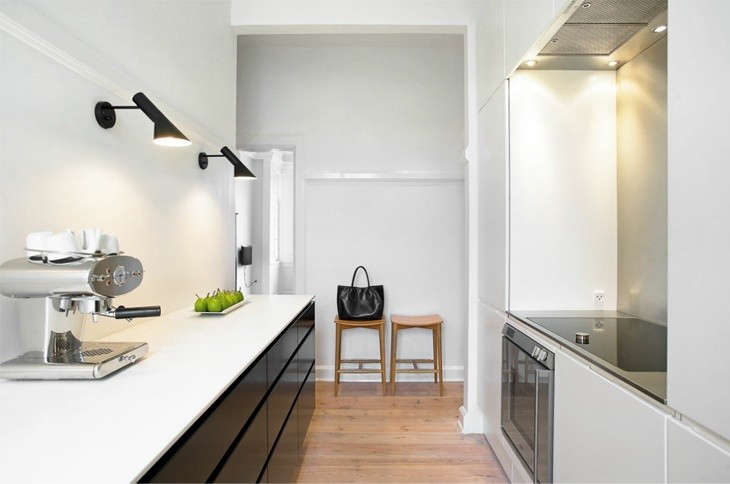 Beau Above: A Pair Of Black Arne Jacobsen AJ Wall Sconces ($946 Each) From  Design Within Reach In A Kitchen Via Bo Bedre.