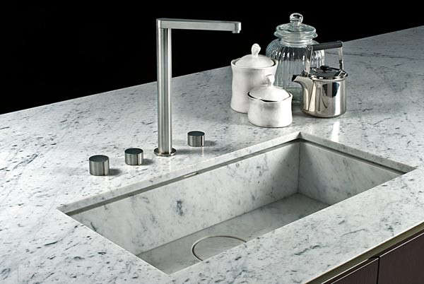 An inset marble sink with marble stopper by Italian kitchen makers Boffi.
