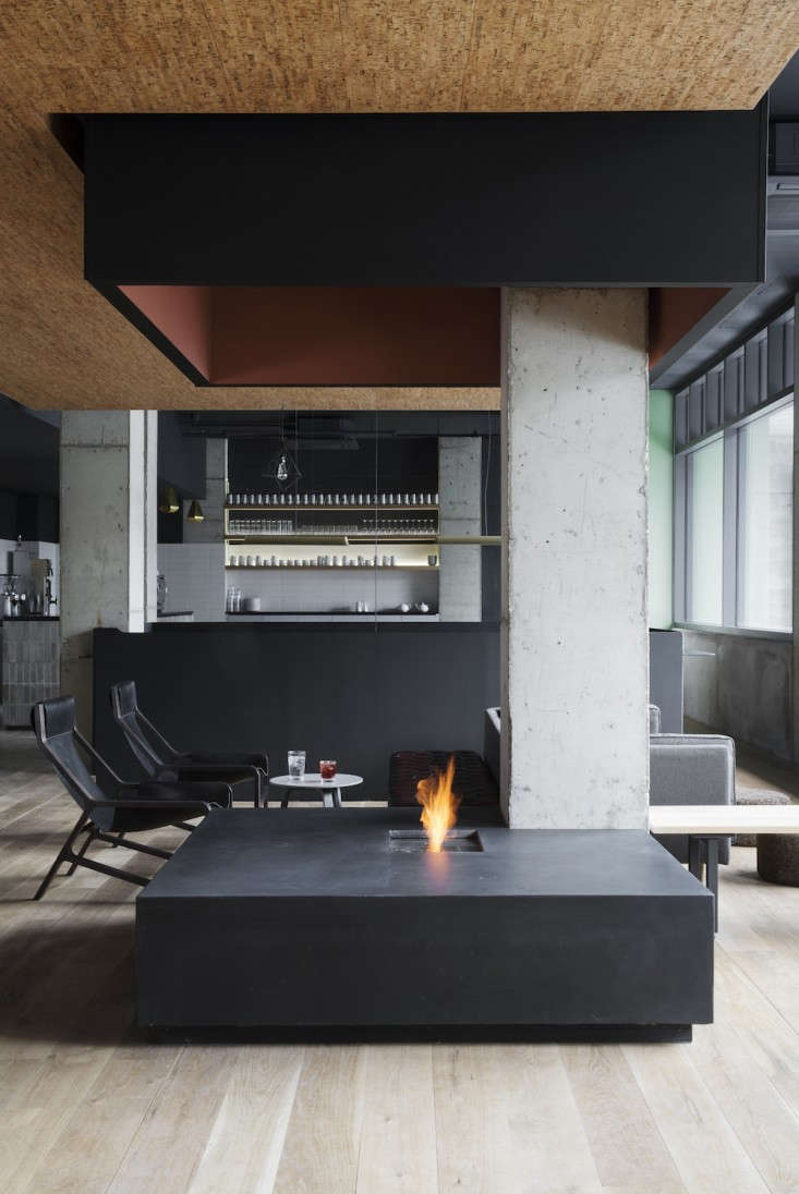 Above A Minimalist Fire Pit In The Center Of Hotels Lobby And Lounge Area