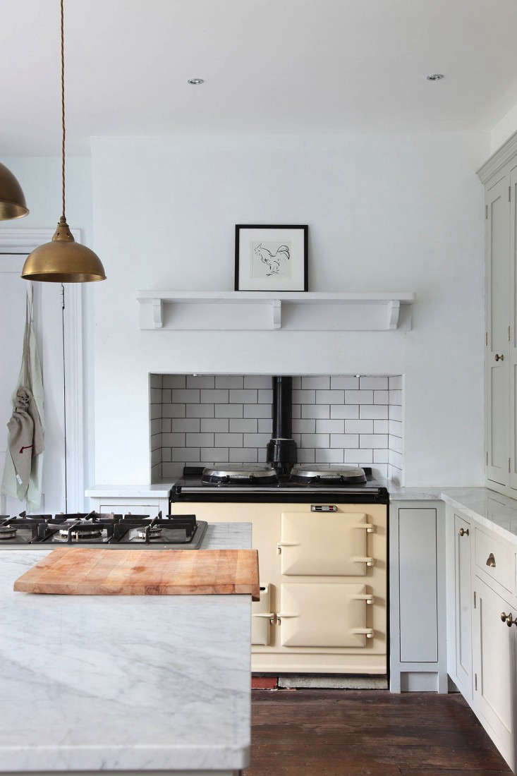 Classic White Subway Tile In An Inset Backsplash From Steal This Look:  Minimalist English Kitchen