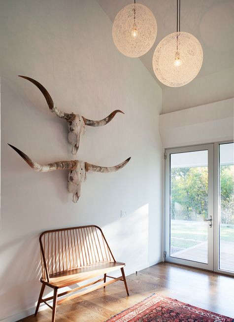 Cool Above A pair of bullhorns in an entryway see more at Home for the Holidays A Modern Farmhouse in Missouri