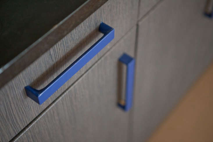 Or, wrap cabinet pulls in tape (these, in Rental Rehab: The DIY New York Apartment, are wrapped in textured blue duct tape cut with an X-Acto knife); rope or cloth could also work.