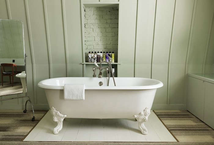 Good Above A rolltop bath and Cowshed toiletries