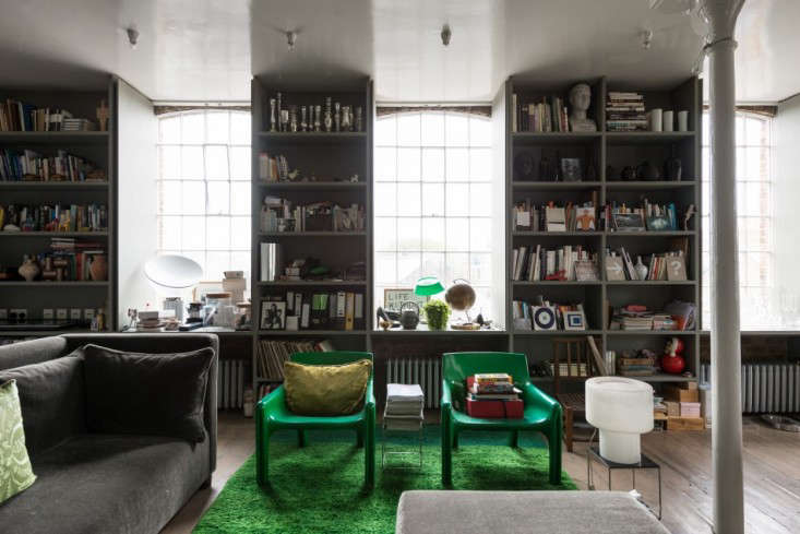 Inspirational Above Large original sash windows run along the south side of the building Floor to ceiling bookcases run the length of the room