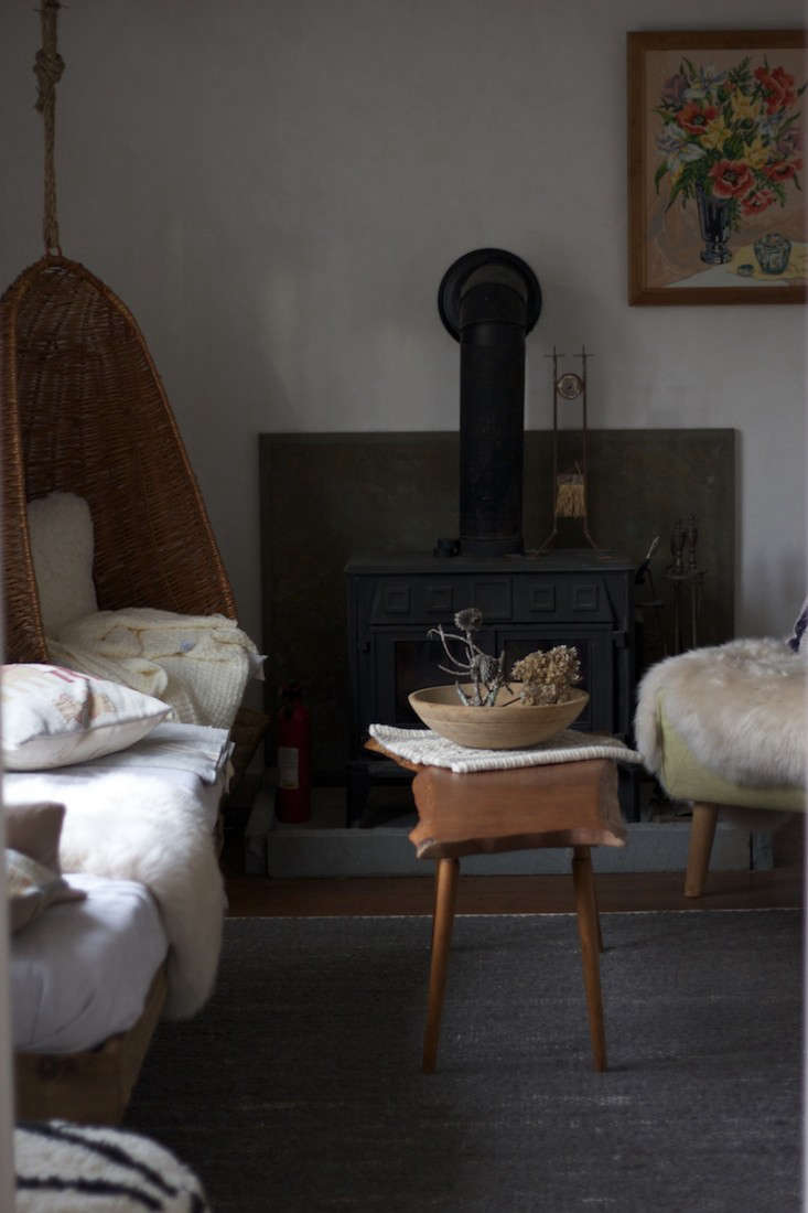 Polar vortex essentials: sheepskins and a wood stove. Photograph by Tara Mangini.from The One-Month Remodel: A Catskills Guesthouse by Jersey Ice Cream Co.