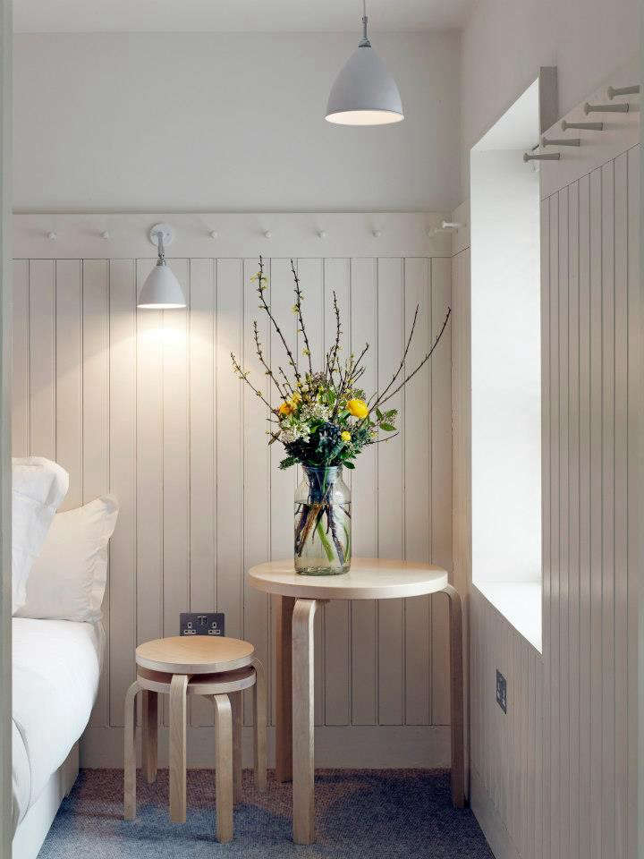 "The small ""post-supper"" rooms at One Leicester Street have simple fittings, including beadboard paneling bordered by white peg rails. See One Leicester Street in London: Come for Dinner, Stay the Night."
