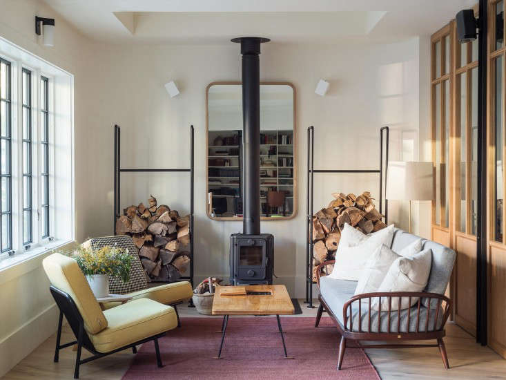 Above Custom Log Racks Designed By Workstead And Manufactured Arrowhead Flank A Freestanding Fireplace Mors The Furniture Includes Two Lounge