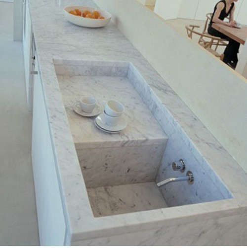 Above A Carrara Marble Sink In The London Kitchen Of Italian Architect Claudio Silvestrin