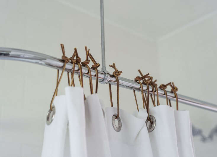 Another place where leather ties come in handy: as shower curtain holders, instead of standard-issue plastic rings. Sarah made the swap in her own bathroom; see Expert Advice: 10 Tips for Transforming a Rental Bath.