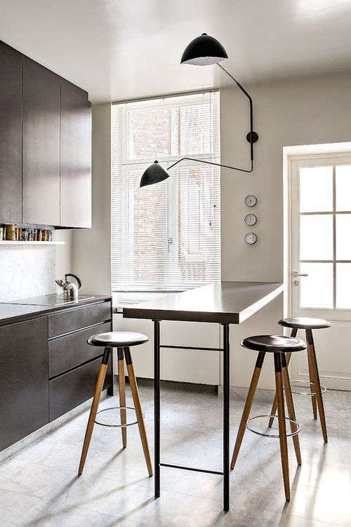 Above: A Serge Mouille Two Arm Wall Sconce ($5,200 From Design Within  Reach) In A Kitchen Photographed By Ricardo Laguiole For Serge Mouille.