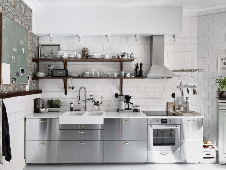 White square tiles in a Swedish kitchen fromKitchen of the Week: An Industrial Yet Romantic Swedish Kitchen.