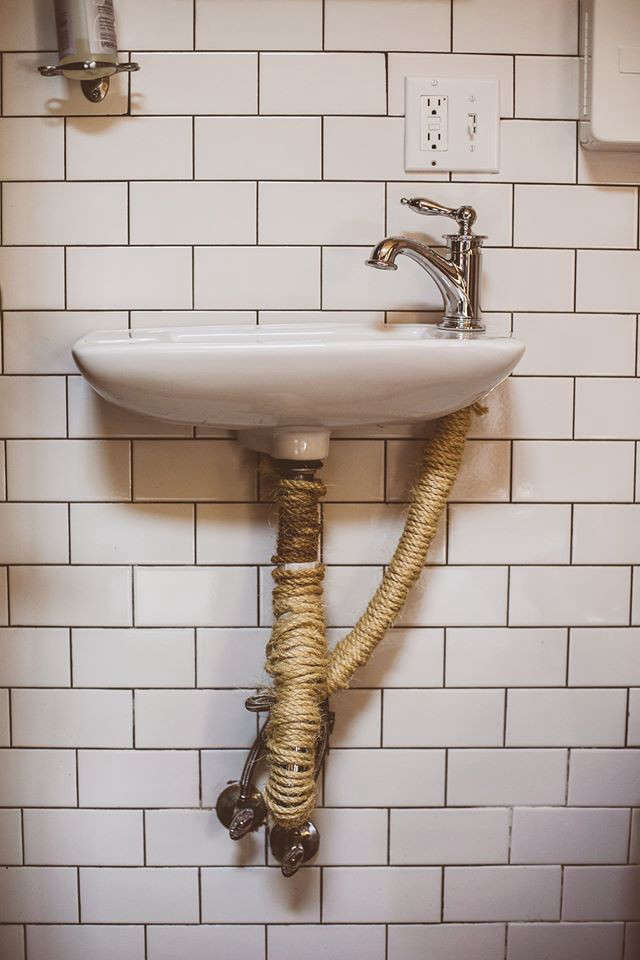 Don't like the look of ugly, rusted pipes under the sink? Wrap them in rope, as seen at Urban Cowboy: A Williamsburg Clubhouse for Nomads.