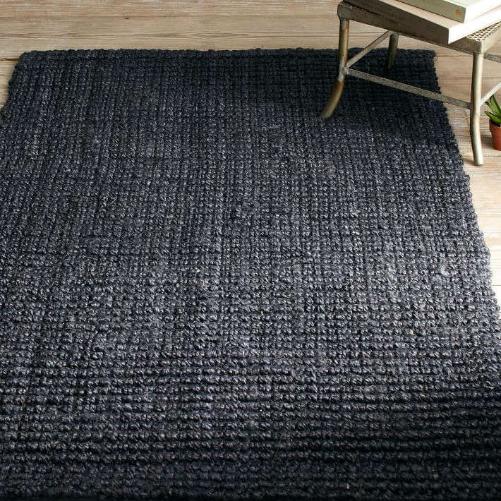 Above The Jute Boucle Rug In Iron Is Handwoven Southern India From Dark Colored Fibers 349 At West Elm
