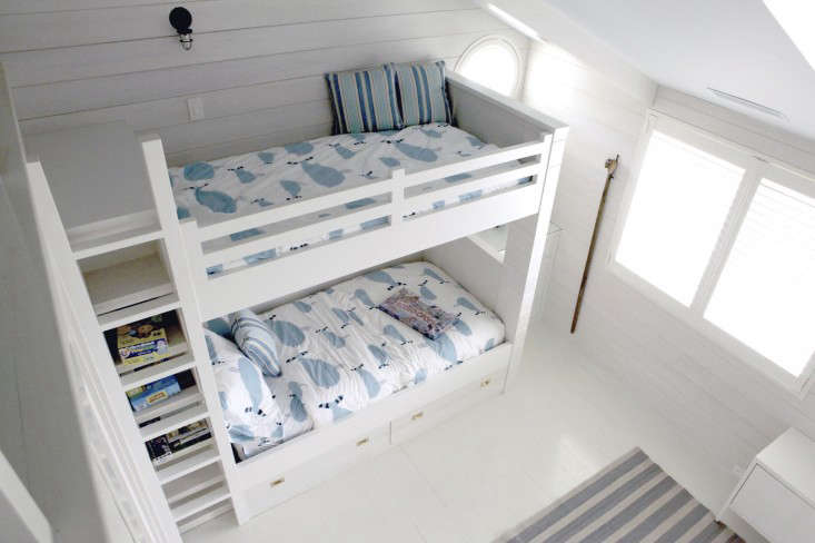 Inspirational Above Built in bunk beds give way to additional storage with bookshelves running up along the side