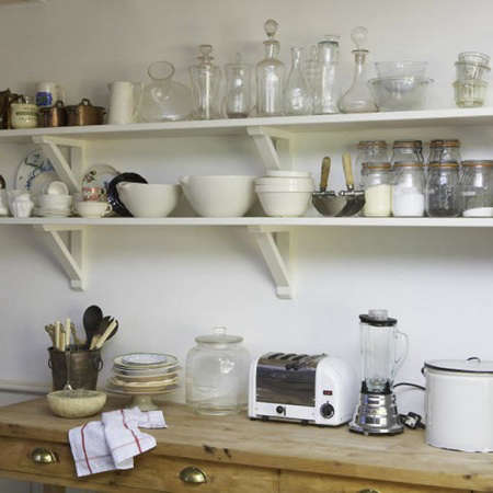 Below: High Kitchen Shelves Provide Storage For Stacks Of White Plates.  Photo By Colin Streater.