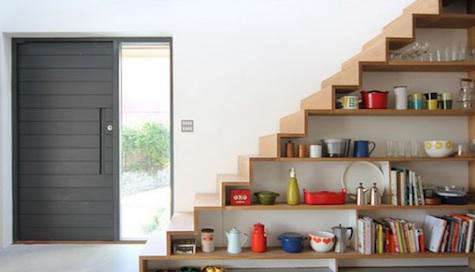 Above two photos  A Scandinavian inspired house by UK based Linea Studio  features kitchen storage shelves under the stairs  photo by Kathryn Tyler Storage  Kitchens Under the Stairs   Remodelista. Under Stairs Kitchen Design. Home Design Ideas