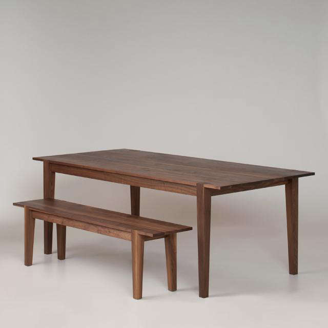above the table and benches of reclaimed black walnut wood comfortably seat up to eight people