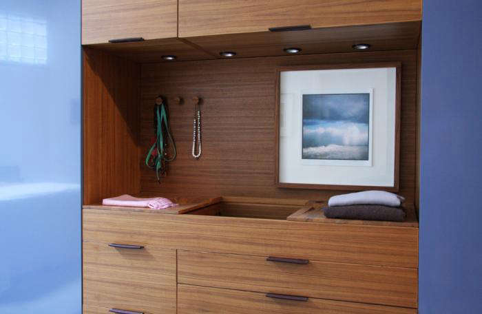 above closet systems include features like leather drawer pulls felt storage pockets and builtin laundry hampers