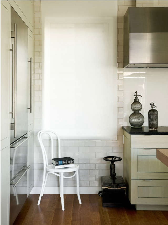 A window was added to let light into this pre-war kitchen in San Francisco; a shade acts as a scrim between the owners and their neighbors.
