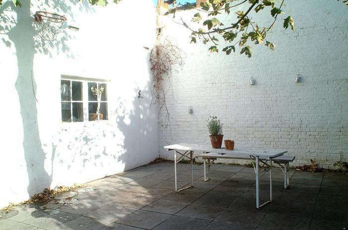 Outdoors Beer Garden Table Painted White Remodelista