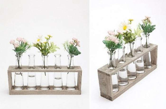 Above A much less costly alternative the Laboratory Flower Vases feature five curved beakers and a distressed wooden rack; $24 at Urban Outfitters. & High/Low: Test Tube Vase - Remodelista