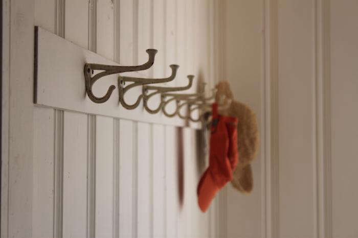 Above: My Auntie Jessie made this custom coat hook rack for her guest room  (see more of this home at Designskool).