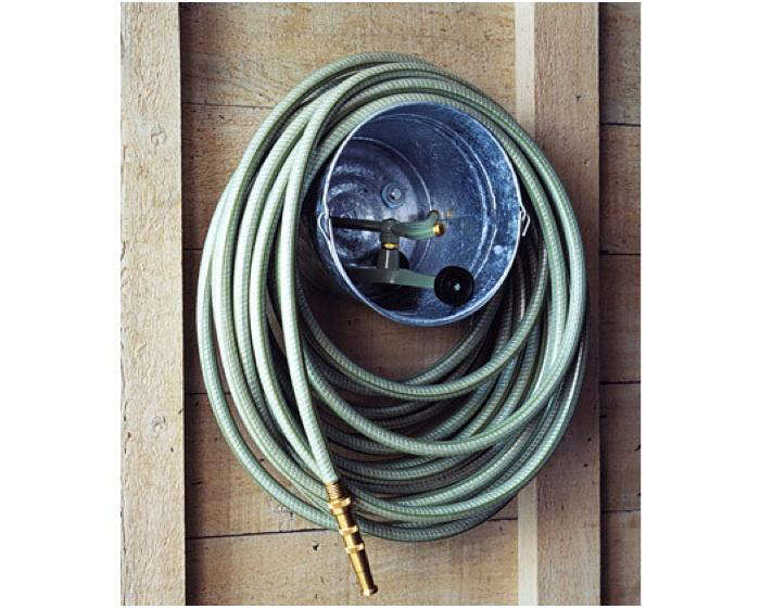 Above: This Galvanized Bucket Bolted To The Wall Not Only Serves As A Hose  Hanger, But Also As A Caddy For The Sprinkler (or Other Gardening  Implements); ...