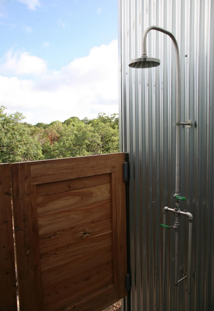 The architect is in a cost effective factory built house for Outdoor shower doors