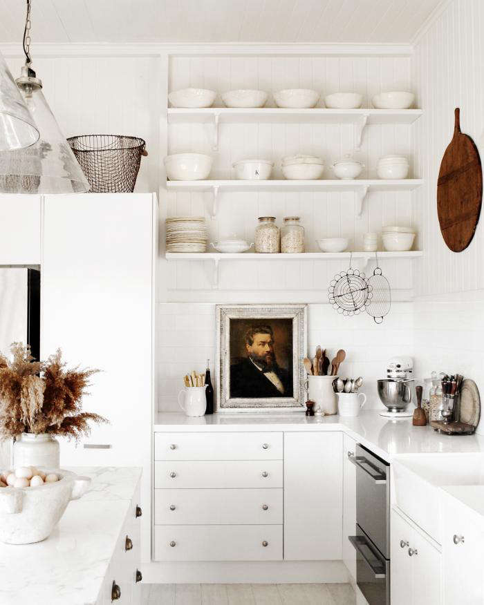 A distinguished portrait is on display amid wooden spoons and pans in a stylist's endlessly changeable cottage kitchen. See Kitchen of the Week: A Blank-Slate Queensland Cottage Kitchen for a Stylist for more. Photograph courtesy of Kara Rosenlund.