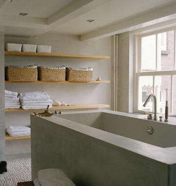 Stunning Above Baskets corral smaller items on open shelving in this contemporary bathroom