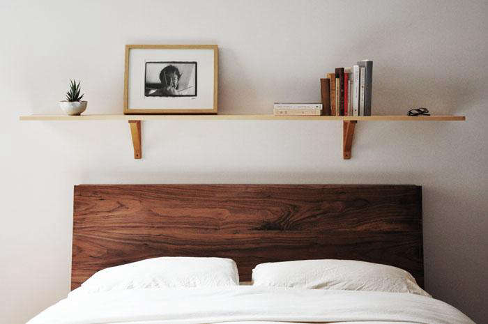 Above: A shelf over the bed functions as a display area.