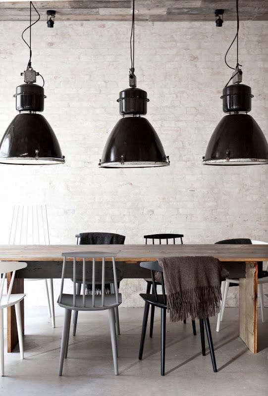 At Restaurant Host in Copenhagen, a row of vintage industrial pendants from Amsterdam shop 360 Volt illuminates the dining room. For more, go toThe Viking Table Reimagined: Restaurant Höst in Copenhagen.