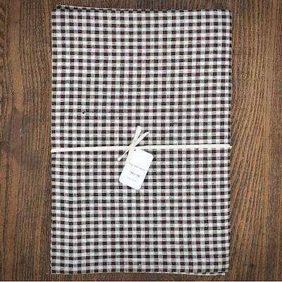 Above: Fog Linen Brown Check Linen Tablecloth (51 By 71 Inches); $85 At  Horne.