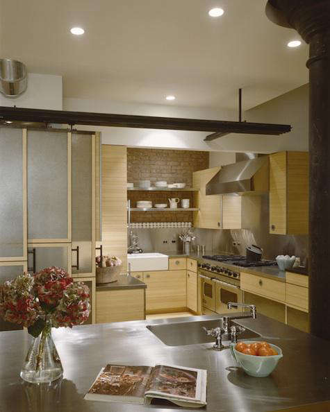 Beautiful Above The kitchen island features a stainless steel countertop with integrated sink and double jointed deck mount faucet Photo by Durston Saylor