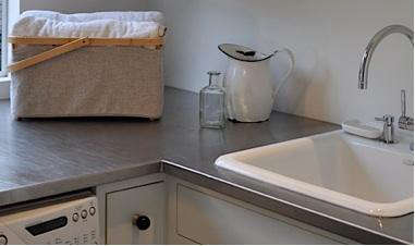 Above: Allison Used A Stainless Steel Countertop From A Local Restaurant  Supplier; Her Countertop Is 35 Inches Deep To Allow Room For Folding Or  Ironing.