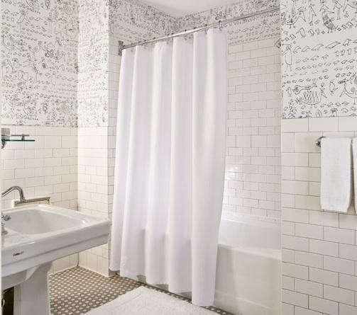 Luxury We especially like Sofield us all white baths which have a jazzy urban edge thanks to the kinetic wallpaper by legendary New Yorker magazine cartoonist Saul