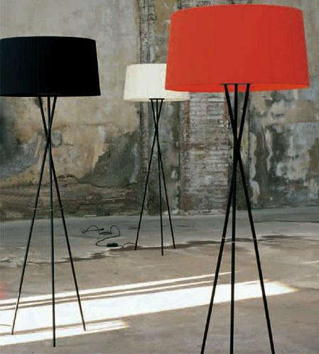 Above a modern classic the spanish made santa cole tripode floor lamp is available with a red black or natural fabric shade the cord extends through