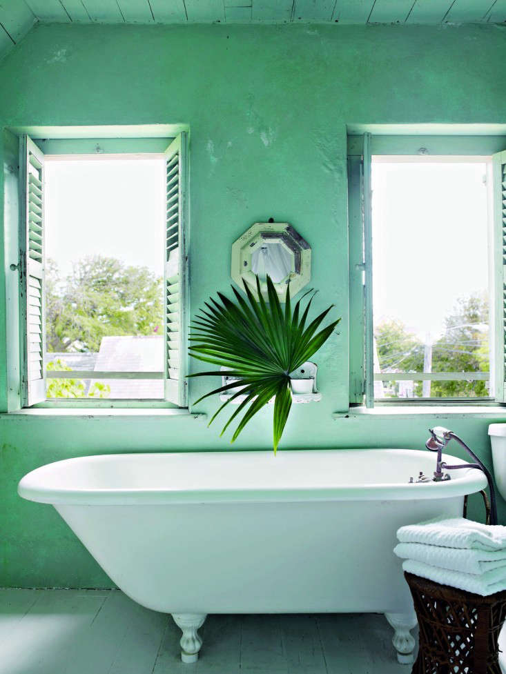 An impossibly happy green in the bath of a Bahamian cottage owned and decorated by Tom Scheerer. Photograph by Francesco Lagnese, courtesy of The Vendome Press, from Island Life: At Home with Tom Scheerer.