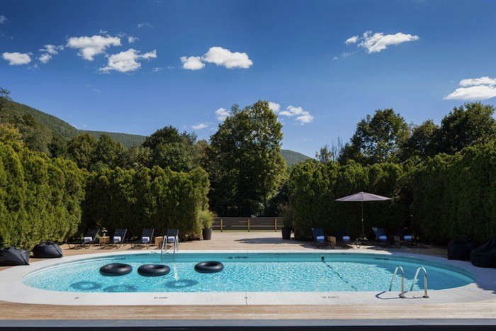 """Hammocks, bicycles, a croquet lawn, and a pool (with inner tubes): you'll find all of these at The Graham & Co. in the Catskills. What you won't find is a TV on the premises,"" writes Isabella. Photograph by Paul Ober, from A New Catskills Getaway, Croquet Included."