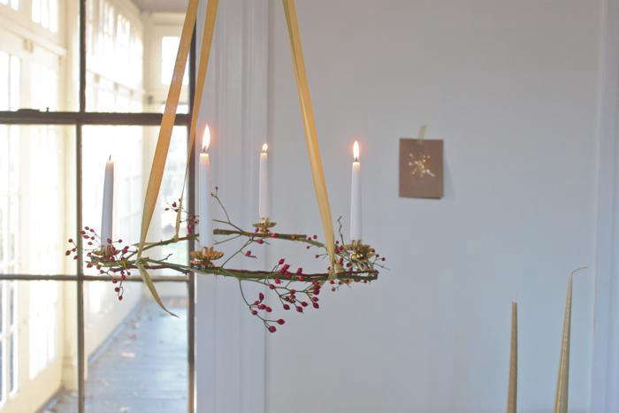 Borrow a tradition from Austria, and so many other European countries, by lighting—with care and supervision—an advent wreath. (Concerned about safety? Swap in faux clip-on lights.) You can make this one yourself; seeDIY: Simple Advent Wreaths Made from Foraged Flora.