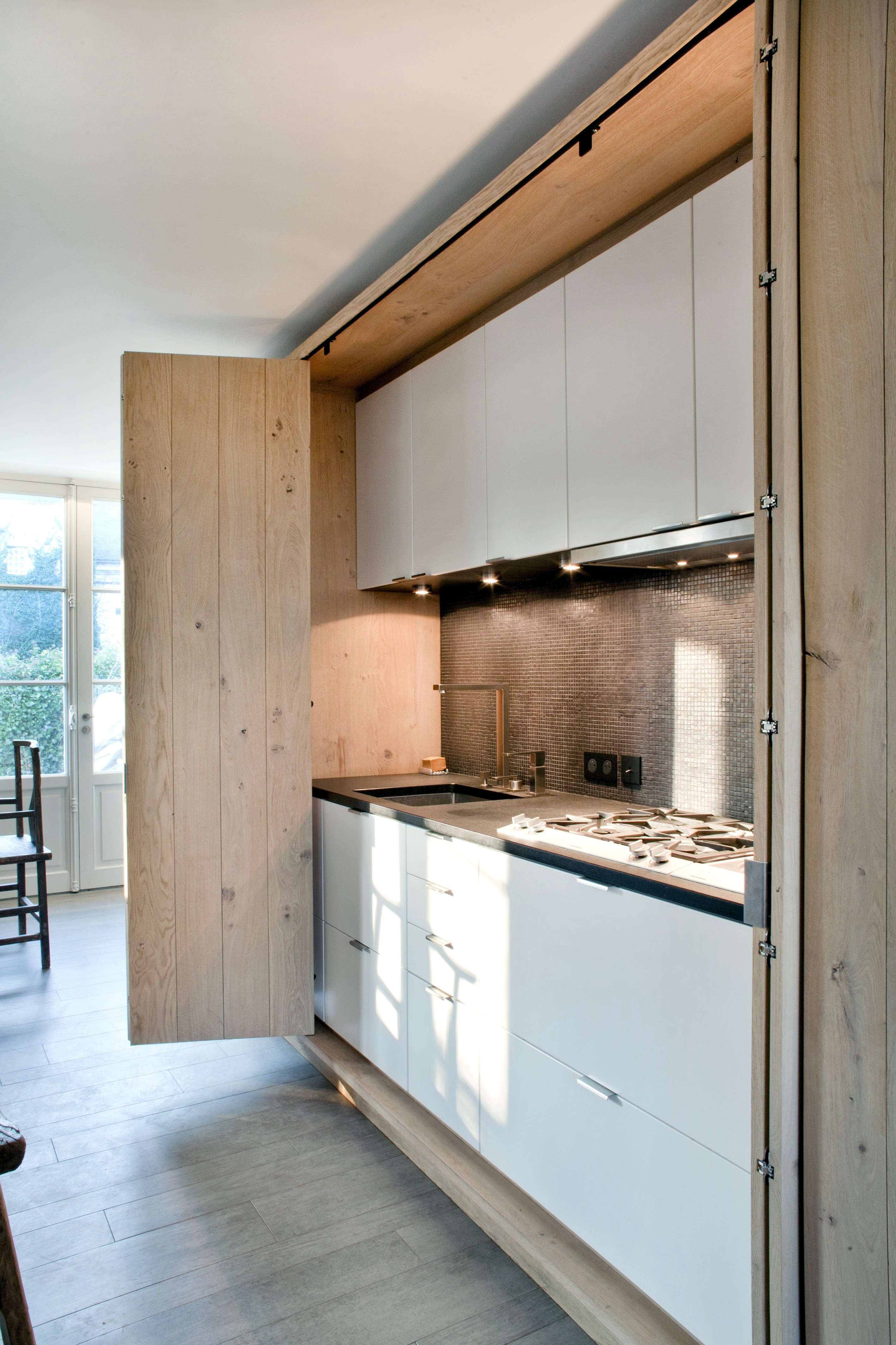 Attrayant Above: French Architect Olivier Chabaud Concealed An Entire Kitchen Behind  Folding Doors In This Country House.