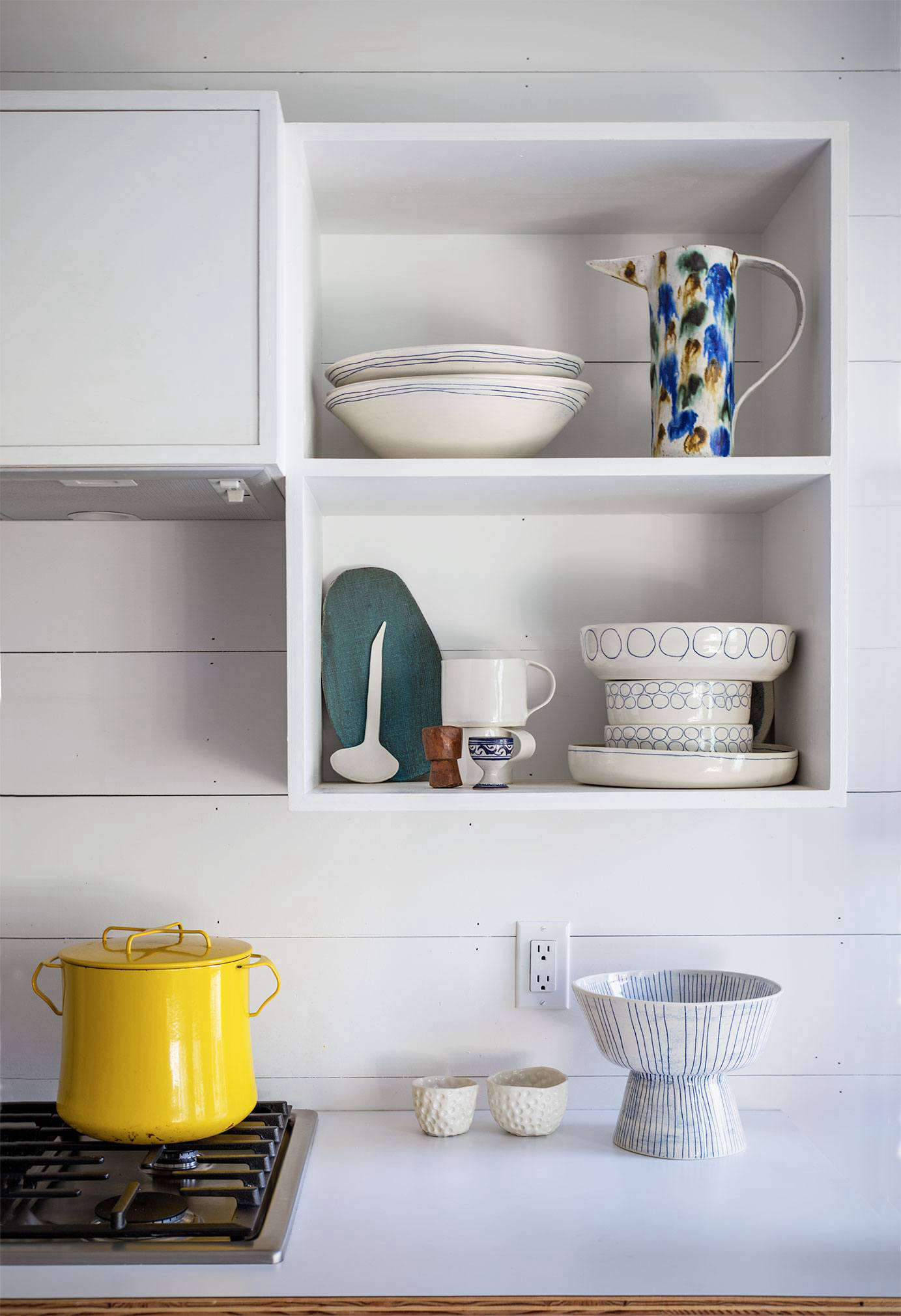 Paula's open shelves provide a place to display her wares.