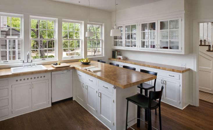 Delightful White Traditional Kitchen With Butcher Block Countertops