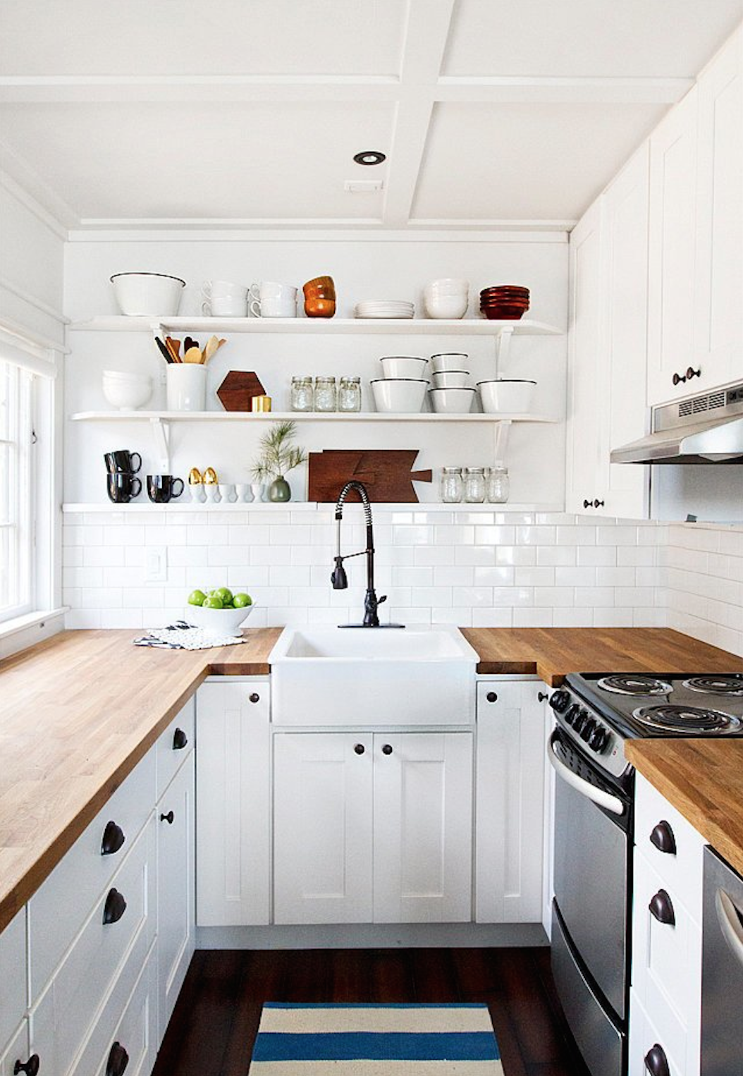 In her cabin kitchen, Sarah Samuel of Smitten Studio installed Ikea's  affordable edge-grain