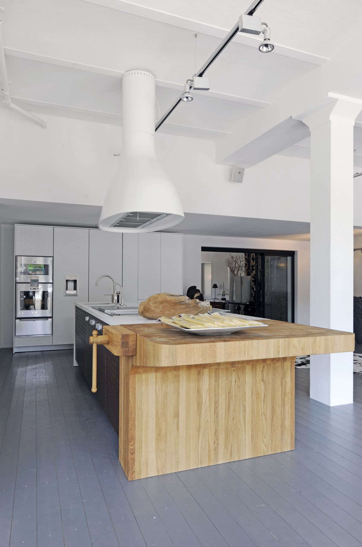 Italian kitchen designers schiffini use end grain butcher block at the end of a kitchen