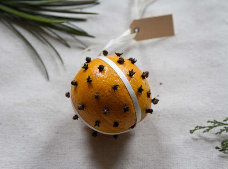 """Who knew this old-school holiday favorite traces its roots to France? Pomanders (frompomme d'ambre, meaning """"amber apple"""") were originally worn or carried as an early form of perfume in the Middle Ages. Make this simple version with cloves to hang in the house or give as a gift; for instructions, seeGift Guide: 3 Last-Minute DIY Holiday Gifts."""