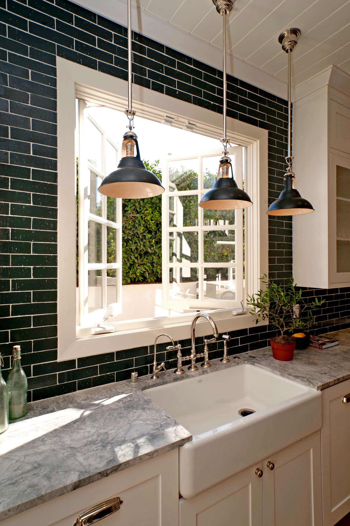 Economical black-painted brick veneer tiles in a kitchen by Leigh Herzig   Remodelista